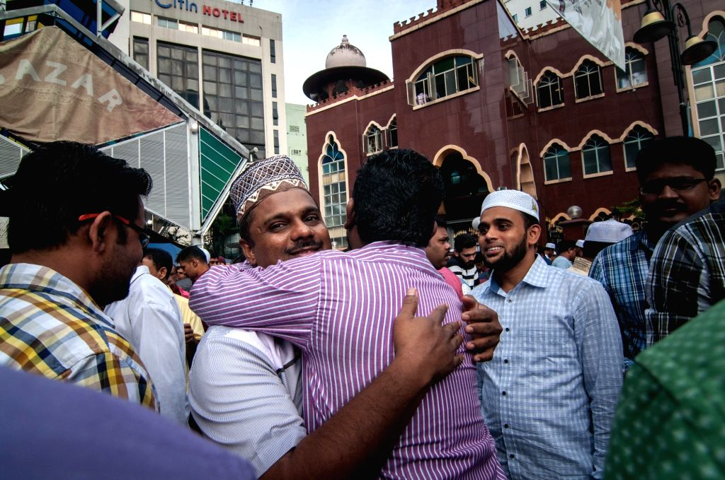 KUALA LUMPUR, June 25, 2017 - People hug each other after a prayer in celebration of the Eid al-Fitr in Kuala Lumpur, Malaysia, June 25, 2017. Muslims around the world celebrated the Eid al-Fitr ...