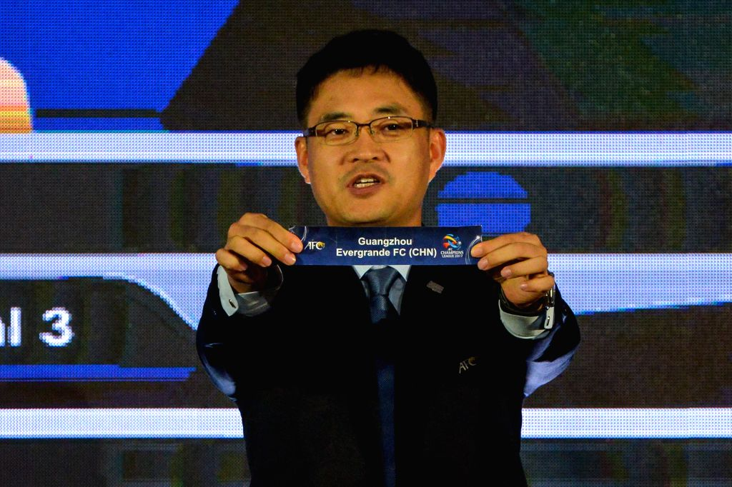KUALA LUMPUR, June 6, 2017 - Executive Director AFC Competitions Division, Shin Man Gil, shows the ballot of the Guangzhou Evergrande Taobao Football Club of China during the AFC Champions League ...