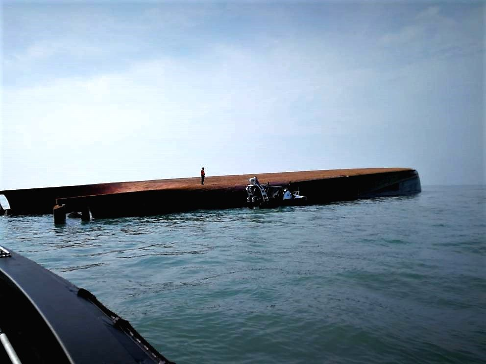 KUALA LUMPUR, March 21, 2018 - Photo provided by Malaysian Maritime Enforcement Agency on March 21, 2018 shows the capsized sand mining vessel in the waters off Malaysia in the Malacca Strait. A sand ...