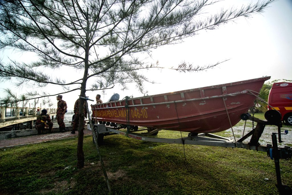 KUALA LUMPUR, March 21, 2018 - Rescuers prepare a speedboat for rescuing the missing crew members of a capsized sand mining vessel, in Parit Jawa in southern Malaysian state of Johor, on March 21, ...