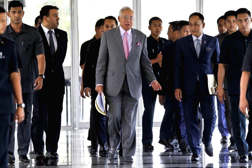 KUALA LUMPUR, March  28, 2018 - Malaysian Prime Minister Najib Razak (C) arrives at the Parliament in Kuala Lumpur, Malaysia, March 28, 2018. The Malaysian parliament on Wednesday passed a motion to ... - Najib Razak