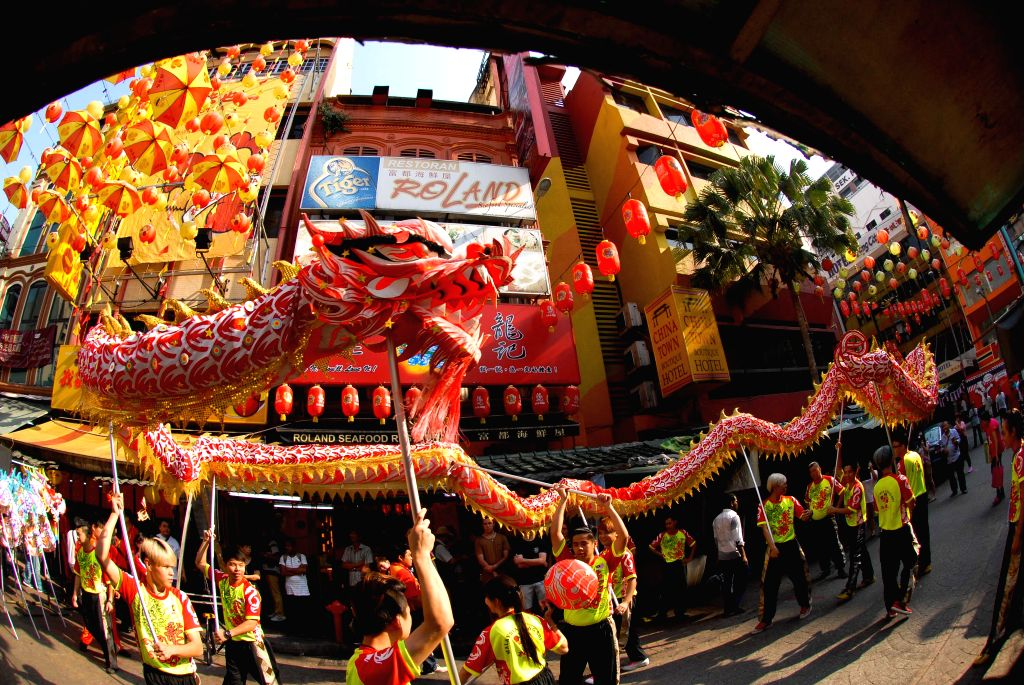 Actors perform a dragon dance to celebrate the Lantern Festival in Kuala Lumpur, Malaysia, March 5, 2015. The festival, which falls on March 5 this year, is ...