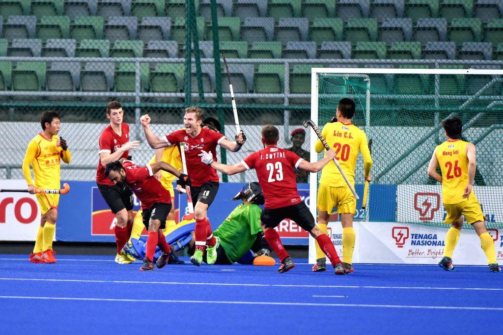 KUALA LUMPUR, May 1, 2019 - Canadian players celebrate scoring during the FIH Men's Series Finals Kuala Lumpur 2019 cross-over match between China and Canada in Kuala Lumpur, Malaysia, May 1, 2019. ...