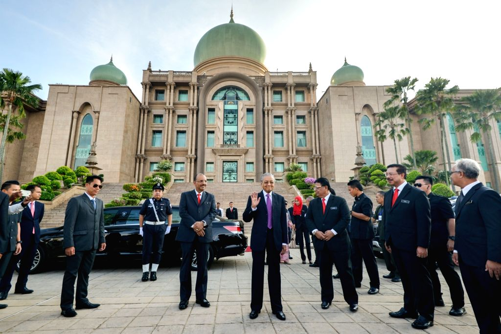KUALA LUMPUR, May 21, 2018 - Malaysian Prime Minister Mahathir Mohamad (C) arrives at the Prime Minister's Office in Putrajaya, Malaysia, May 21, 2018. Core members of the cabinet led by newly ... - Mahathir Mohamad