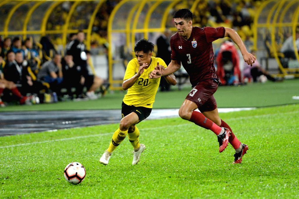 KUALA LUMPUR, Nov. 15, 2019 - Muhammad Syafiq Ahmad (L) of Malaysia vies with Yusef Elias Dolah of Thailand during the group G match at the FIFA World Cup Qatar 2022 and AFC Asian Cup China 2023 ...