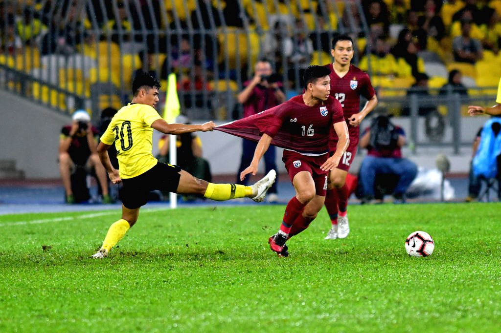 KUALA LUMPUR, Nov. 15, 2019 - Muhammad Syafiq Ahmad (L) of Malaysia vies with Phitiwat Sookjitthammakul (C) of Thailand during the group G match at the FIFA World Cup Qatar 2022 and AFC Asian Cup ...