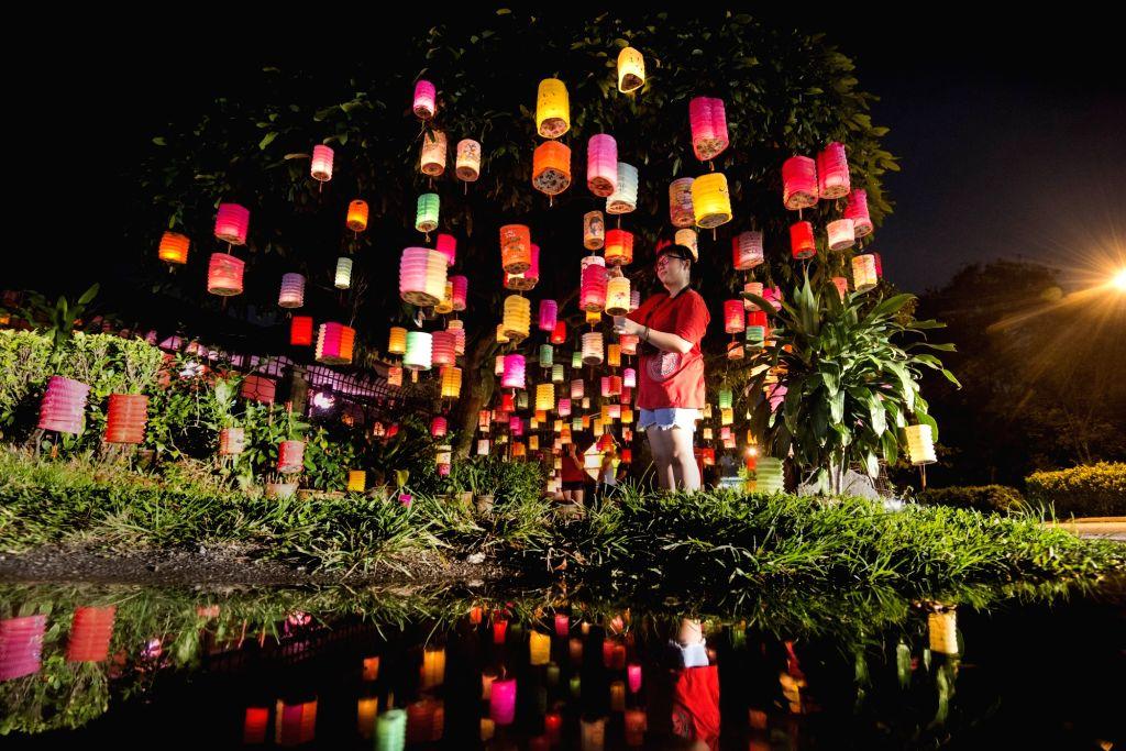 KUALA LUMPUR, Oct. 4, 2017 - A girl lights up a lantern to celebrate the Mid-autumn Festival in Kuala Lumpur, capital of Malaysia, Oct. 4, 2017.