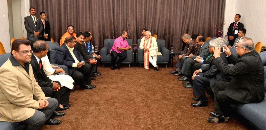 Kuala Lumpur: Prime Minister Narendra Modi meets the MPs and MLAs of Indian origin, in Kuala Lumpur, Malaysia on Nov 22, 2015. - Narendra Modi