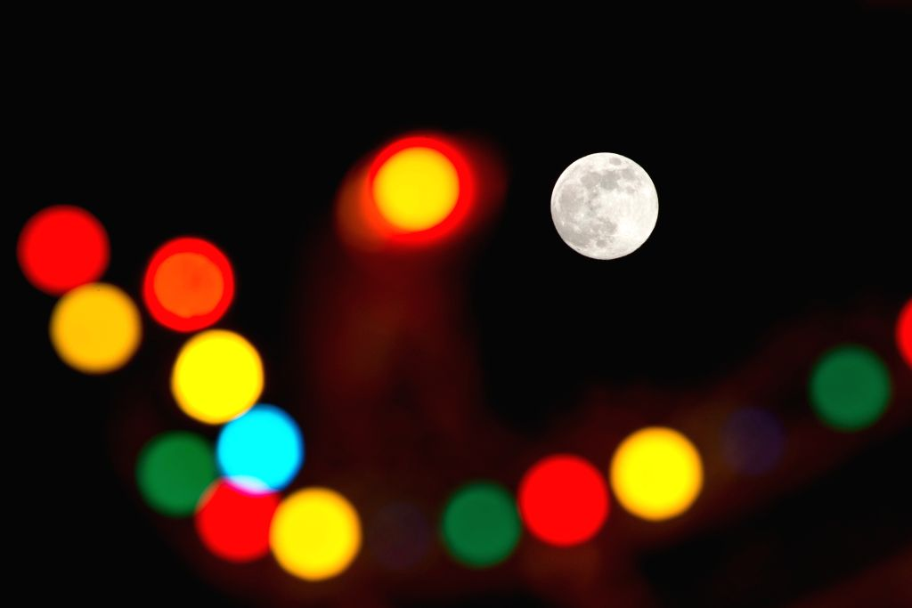 Photo taken on Sept. 8, 2014 shows a full moon rise over Kuala Lumpur, Malaysia. People of Malaysia celebrates Mid-Autumn Festival on Monday. (Xinhua/Chong Voon