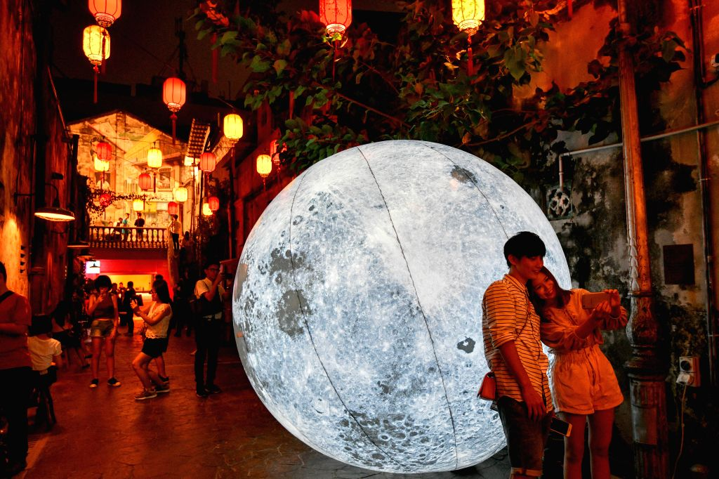 KUALA LUMPUR, Sept. 13, 2019 - People take selfies with a giant moon balloon to celebrate the Mid-Autumn Festival at a Chinese community in Kuala Lumpur, Malaysia, Sept. 13, 2019.
