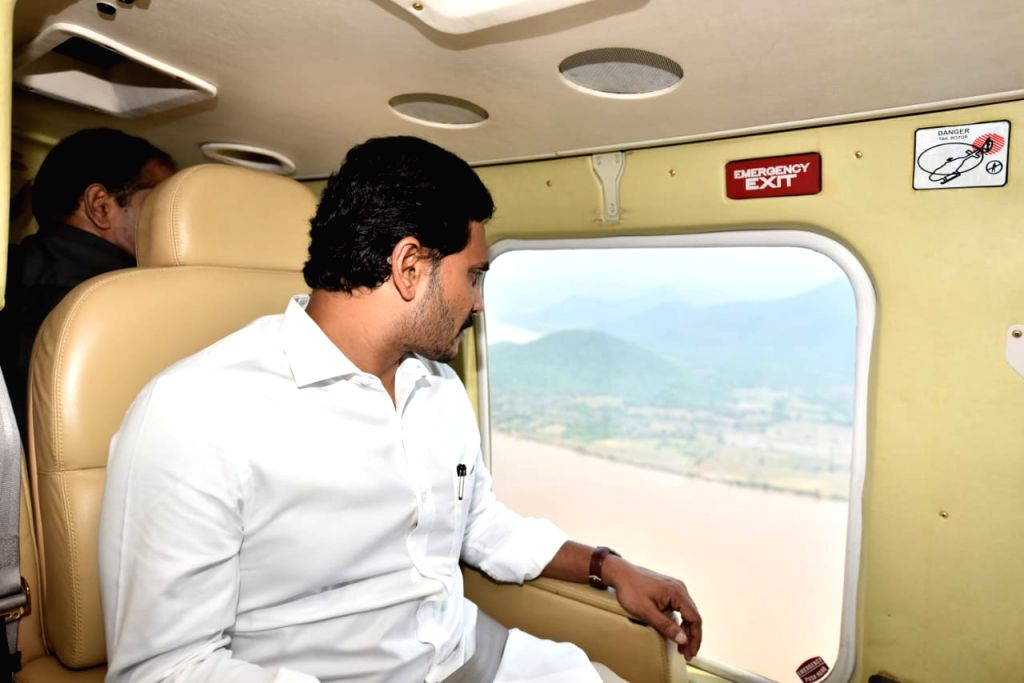 Kuchuluru: Andhra Pradesh Chief Minister Y. S. Jagan Mohan Reddy conducts an aerial survey of Sunday's boat accident site in Godavari river, on Sep 16, 2019.The Chief Minister flew in a helicopter over Kuchuluru in East Godavari district where a boat - Y. S. Jagan Mohan Reddy