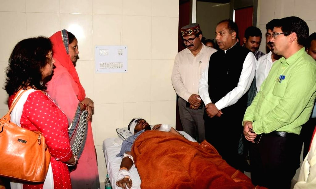 Kullu: Himachal Pradesh Chief Minister Jai Ram Thakur meets those who sustained injuries in a bus accident, at a hospital in Himachal Pradesh's Kullu on June 21, 2019. A total of 73 passengers were on board when an overloaded private mini bus skidded - Jai Ram Thakur