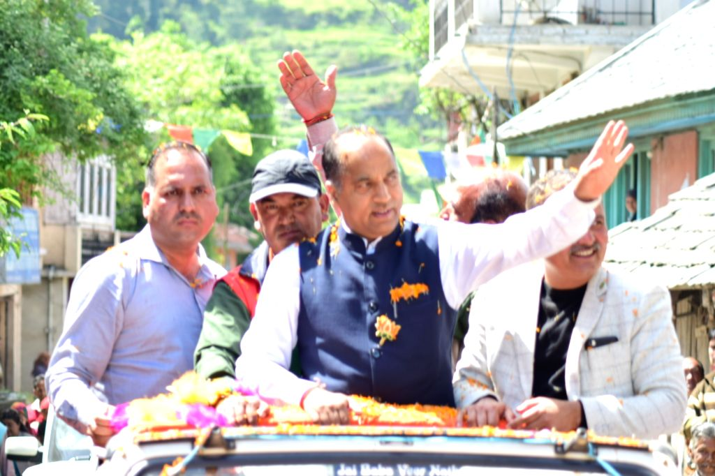Kullu: Himachal Pradesh Chief Minister Jai Ram Thakur waves at supporters during a roadshow ahead of the final phase of 2019 Lok Sabha elections, at Ani in Kullu district of Himachal Pradesh on May 15, 2019. (Photo: IANS) - Jai Ram Thakur