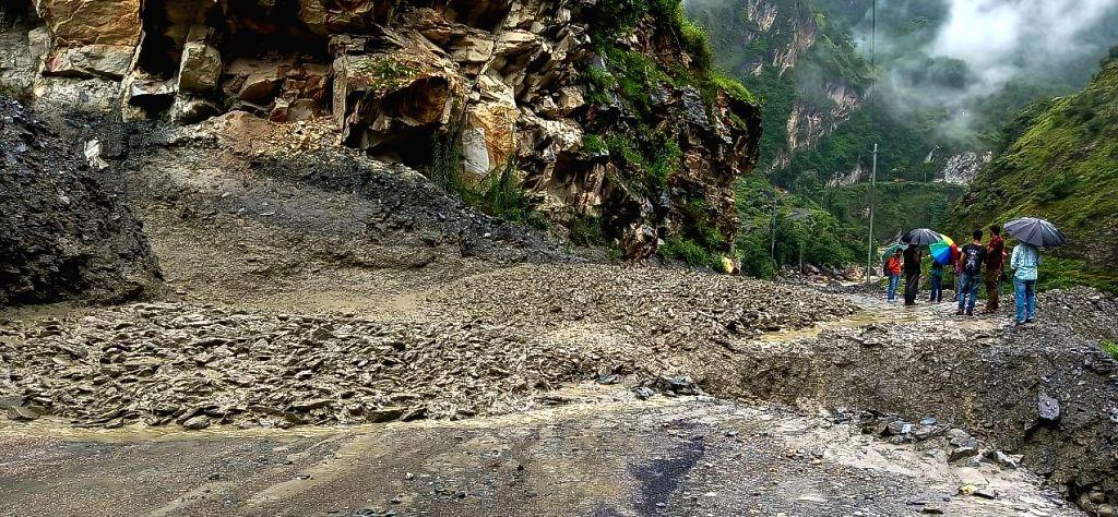 Kullu: Landslide triggered by heavy rains, blocks road at Pagal Nala in Himachal Pradesh's Kullu on Aug 1, 2019. Restoration work is underway to clear the affected stretch. (Photo: IANS)