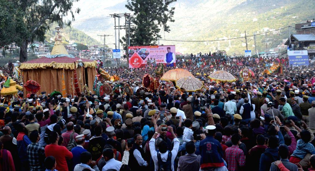 :Kullu: People in large numbers throng Dhalpur ground during inauguration of week-long international Kullu Dussehra festival on Oct 19, 2018. Kullu Dussehra, a centuries-old festival, begins on ...
