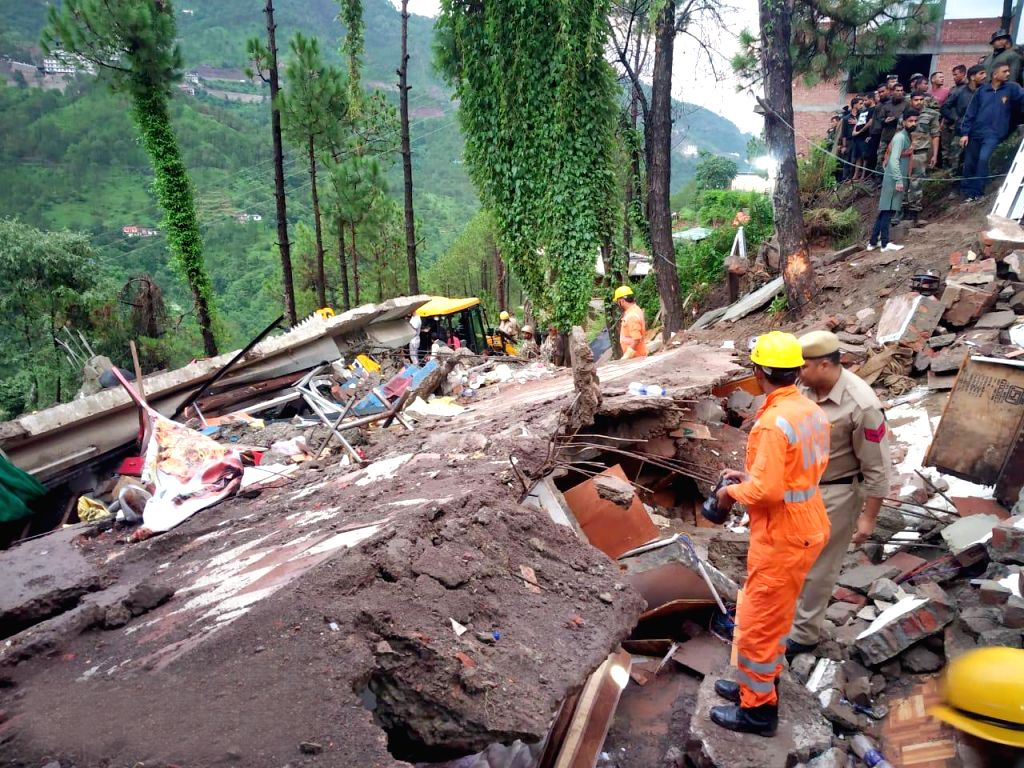 Kumarhatti: Rescue operations underway at the site where a roadside three-storey eatery caved in owing to heavy rains in Kumarhatti in Himachal Pradesh's Solan district on July 14, 2019. At least 10 people were pulled out from the debris while 20 wer
