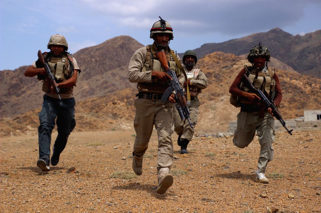 KUNAR, Aug. 15, 2017 - Afghan security force members take part in a military operation in Khas Kunar district of Kunar province, Afghanistan, Aug. 14, 2017.