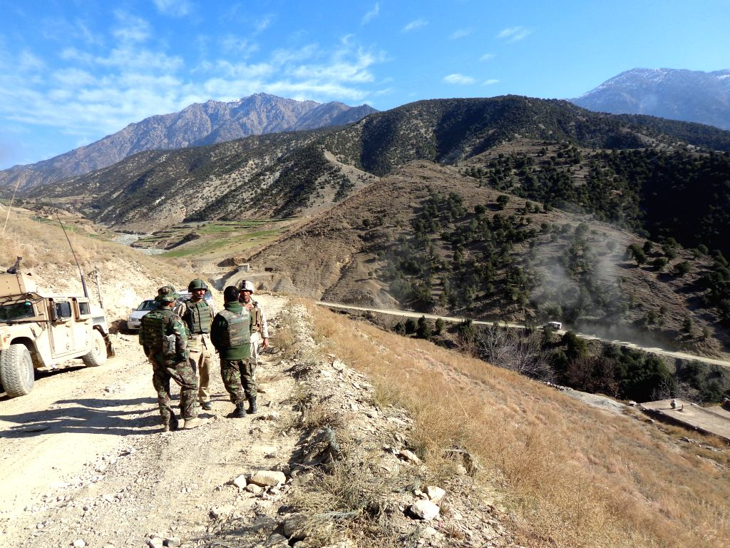 Afghan security forces keep watch during their operation in Dangam district of Kunar province in eastern Afghanistan, Dec. 21, 2014. The Afghan army has waged an ...