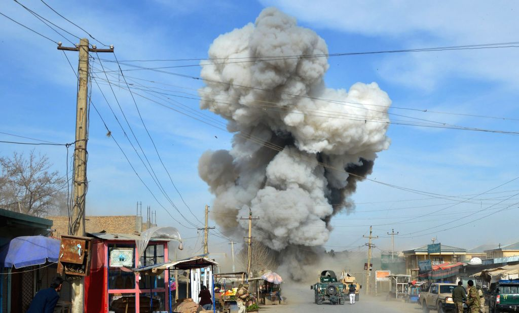 Photo taken on Feb. 10, 2015 shows smoke rising from the site of attack in Kunduz province, northern Afghanistan. A massive suicide attack in northern Afghanistan's .