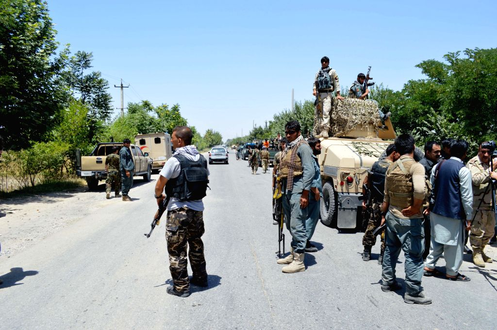 KUNDUZ, May 31, 2016 - Afghan security personnel stand at the site of kidnapping in Kunduz province, Afghanistan, May 31, 2016. The Taliban militants on Tuesday intercepted three long-distance buses ...