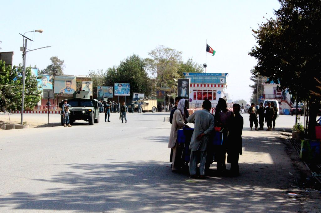 KUNDUZ, Oct. 3, 2016 - Afghan men stand on a road in Kunduz city, Afghanistan, Oct. 3, 2016. Taliban militants launched attacks on northern Kunduz city early on Monday and fierce fighting has been ...