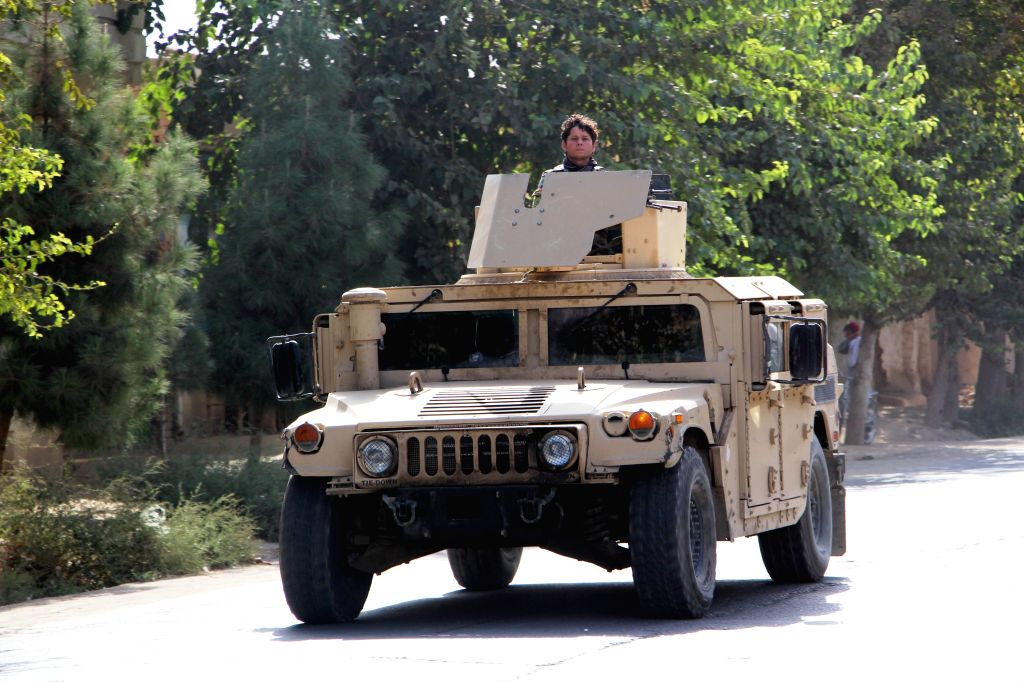 KUNDUZ, Oct. 3, 2016 - An Afghan security force member stands guard on a military vehicle in Kunduz city, Afghanistan, Oct. 3, 2016. Taliban militants launched attacks on northern Kunduz city early ...