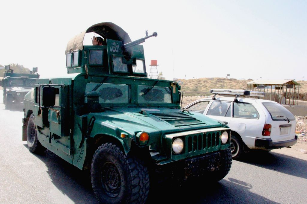 KUNDUZ, Oct. 3, 2016 - Photo taken on Oct. 3, 2016 shows military vehicles in Kunduz city, Afghanistan. Taliban militants launched attacks on northern Kunduz city early on Monday and fierce fighting ...