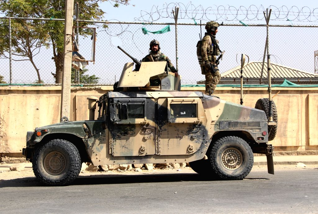 KUNDUZ, Oct. 4, 2016 - Afghan security force members stand on a military vehicle during a military operation against Taliban militants in northern Kunduz city, Afghanistan, Oct. 4, 2016. Afghan ...