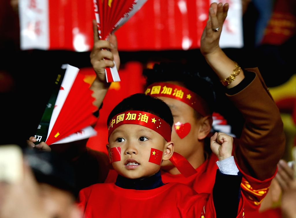 KUNMING, Nov. 15, 2016 - A boy cheers for the team before the Russia 2018 FIFA World Cup qualification match between China and Qatar in Kunming, southwest China's Yunnan Province, Nov. 15, 2016.