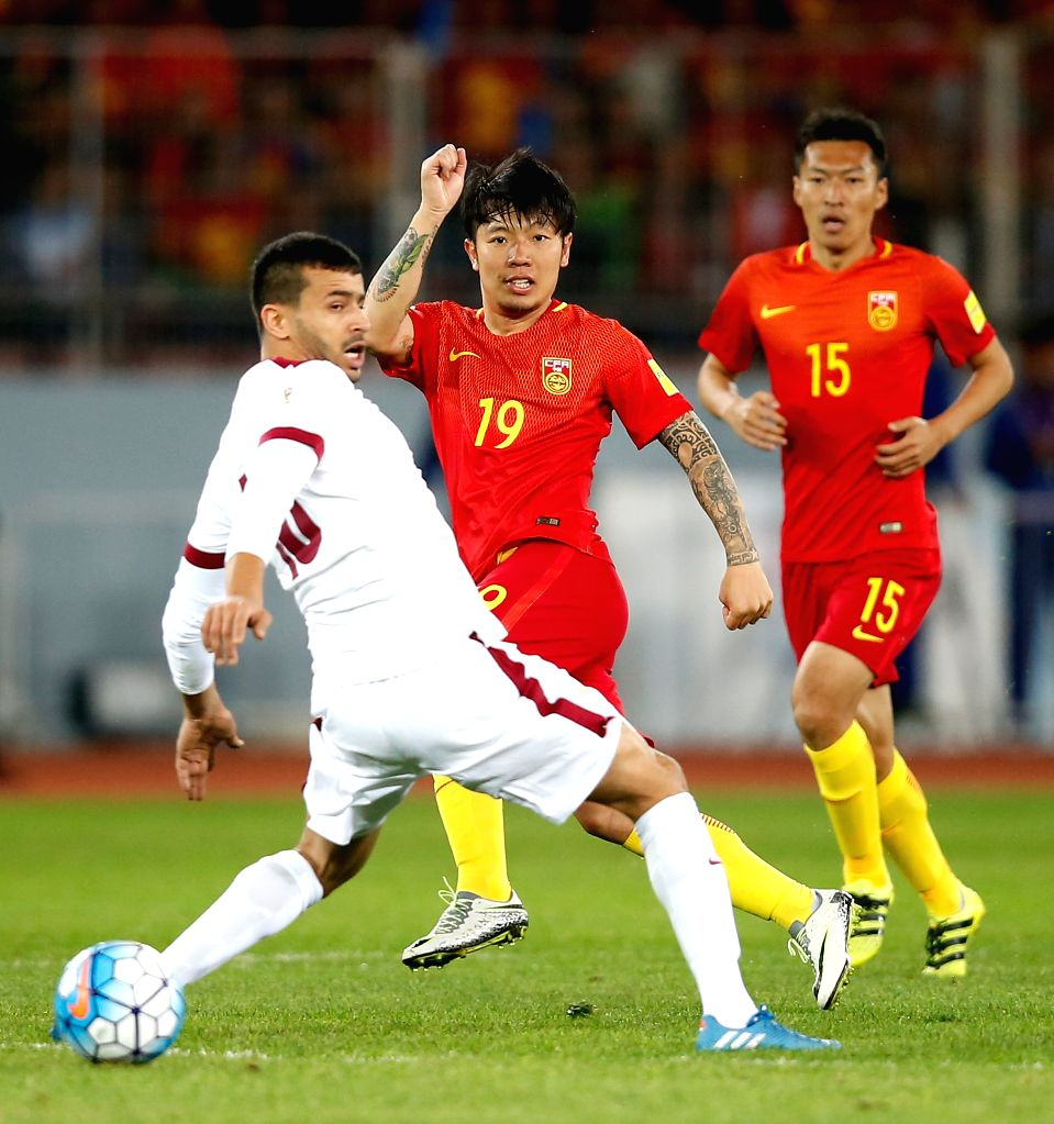 KUNMING, Nov. 15, 2016 - China's Zhang Xizhe (C) vies for the ball during the Russia 2018 FIFA World Cup qualification match against Qatar in Kunming, southwest China's Yunnan Province, Nov. 15, 2016.