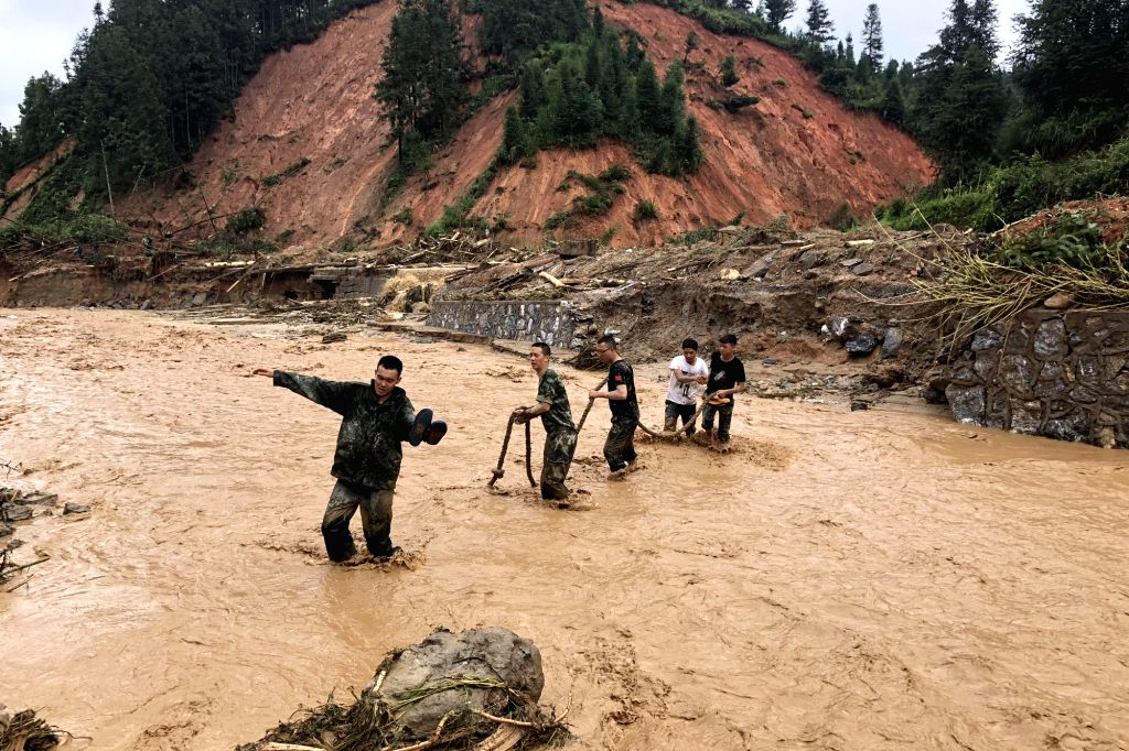 KUNMING, Sept. 3, 2018 - Rescuers work in flood in Mengdong Township in Malipo County of Zhuang and Miao Autonomous Prefecture of Wenshan, southwest China's Yunnan Province, Sept. 2, 2018. A flood ...