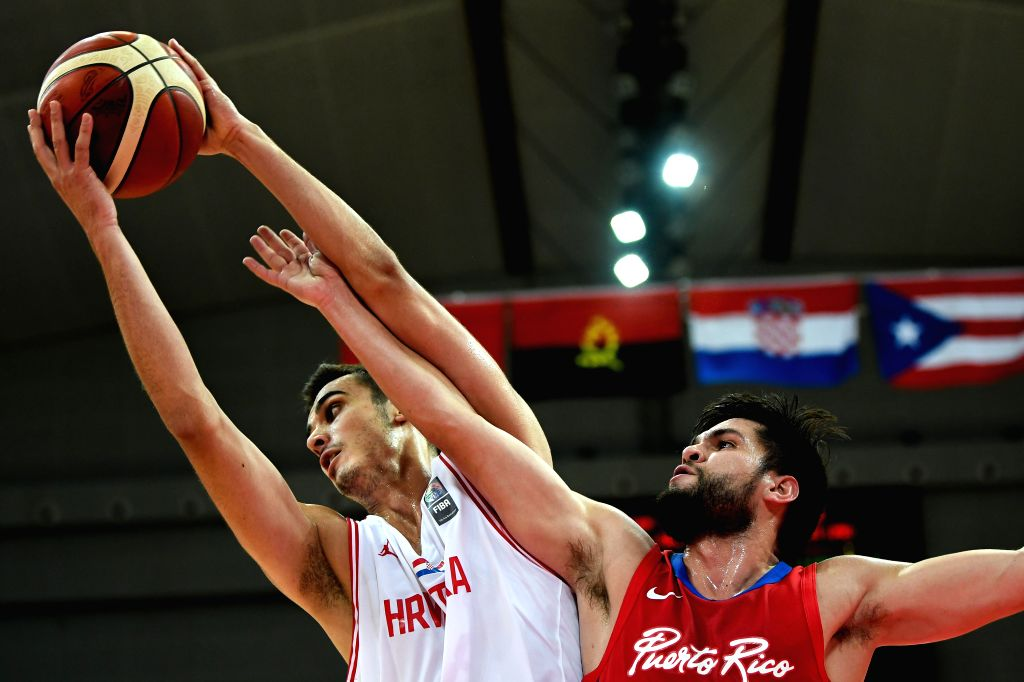 KUNSHAN, Aug. 11, 2019 - Colak Mateo (L) of Croatia vies for a rebound during a match against Puerto Rica at the 2019 International Men's Basketball Challenge in Kunshan, east China's Jiangsu ...