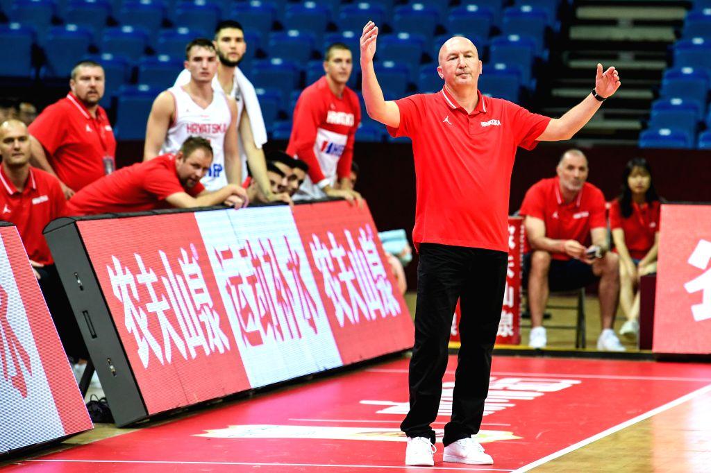 KUNSHAN, Aug. 11, 2019 - Damir Rajkovic, coach of Croatia, gestures during a match against Puerto Rica at the 2019 International Men's Basketball Challenge in Kunshan, east China's Jiangsu Province, ...