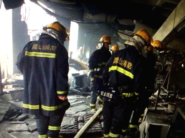 Firefighters search for survivals at the factory blast site in Kunshan, east China's Jiangsu Province, Aug. 2, 2014. A powerful factory blast has killed 65 people ..