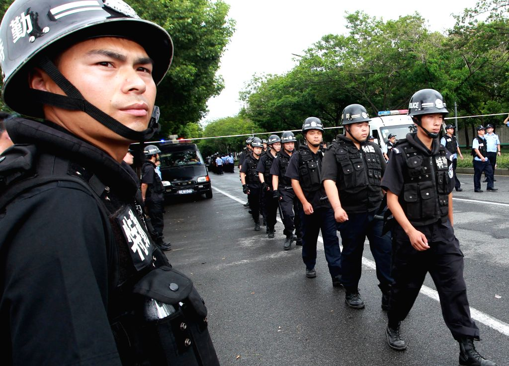 SWAT team guard outside the factory blast site in Kunshan, east China's Jiangsu Province, Aug. 2, 2014. A powerful factory blast has killed 65 people and injured ...