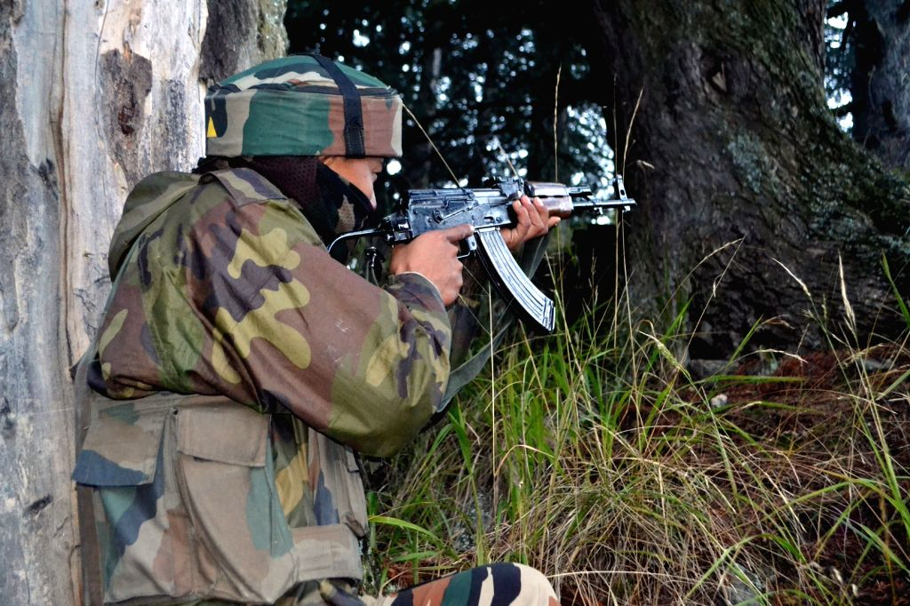 : Kupwara: A soldier in action during an encounter with militants in Kupwara of Jammu and Kashmir on Nov 13, 2015. (Photo: IANS).