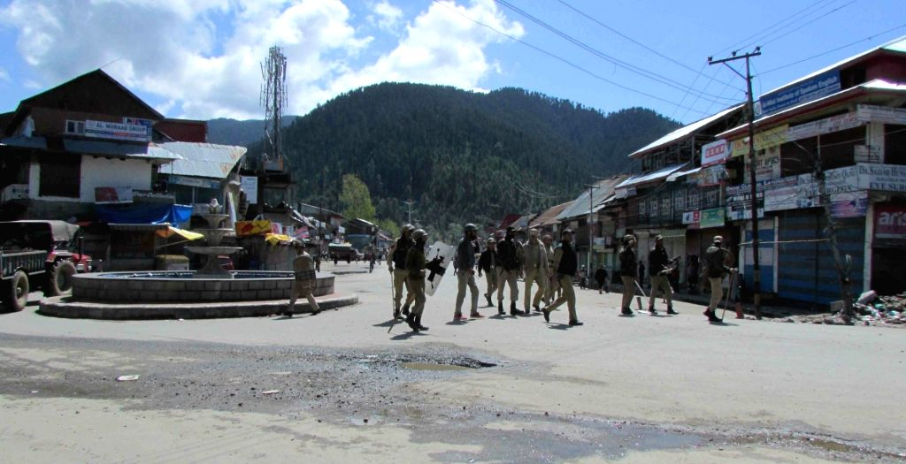 Kupwara : Security personnel enforce curfew in Kupwara of Jammu and Kashmir on April 18, 2016.