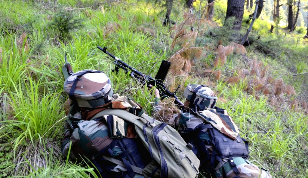 Kupwara: Soldiers take position during an encounter with militants in Jammu and Kashmir's Kupwara district on June 7, 2017. Three militants were killed during an ongoing operation near the Line of Control (LoC) in Machil sector of Kupwara. (Photo: IA