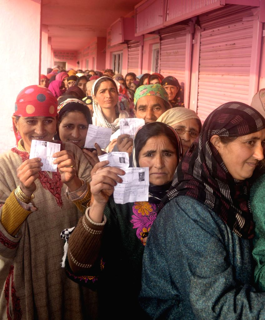 Women queue-up to cast their votes during the second phase of  Jammu and Kashmir assembly polls in Kupwara on Dec 2, 2014.