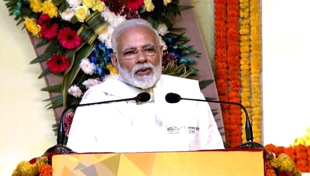 Kurukshetra: Prime Minister Narendra Modi addresses after laying the foundation stone of National Institute of Ayurveda, Panchkula, Pandit Deen Dayal Upadhyaya University of Health Sciences, Karnal, Shri Krishna Ayush University, Kurukshetra, and 'Ba - Narendra Modi