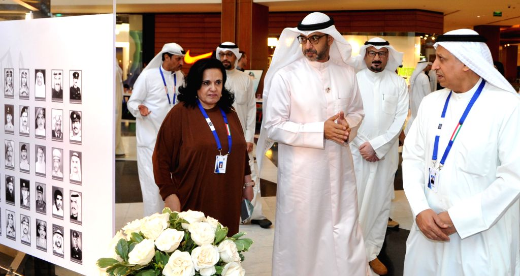 KUWAIT CITY, Aug. 1, 2019 - Acting Minister of Amiri Diwan Affairs Sheikh Mohammad Abdullah Al-Mubarak Al-Sabah (C) views pictures of the martyrs of the Gulf War in Kuwait city, Kuwait, Aug. 1, 2019. ...
