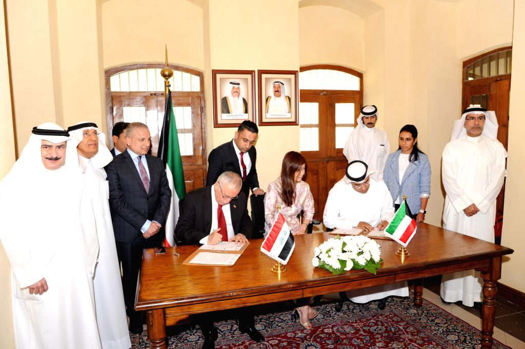 KUWAIT CITY, Aug. 28, 2019 - Officials of the Kuwaiti and Iraqi foreign ministries sign contract of returning books to Kuwait at a handover ceremony, in Kuwait City, Kuwait, on Aug. 28, 2019. Iraq ...
