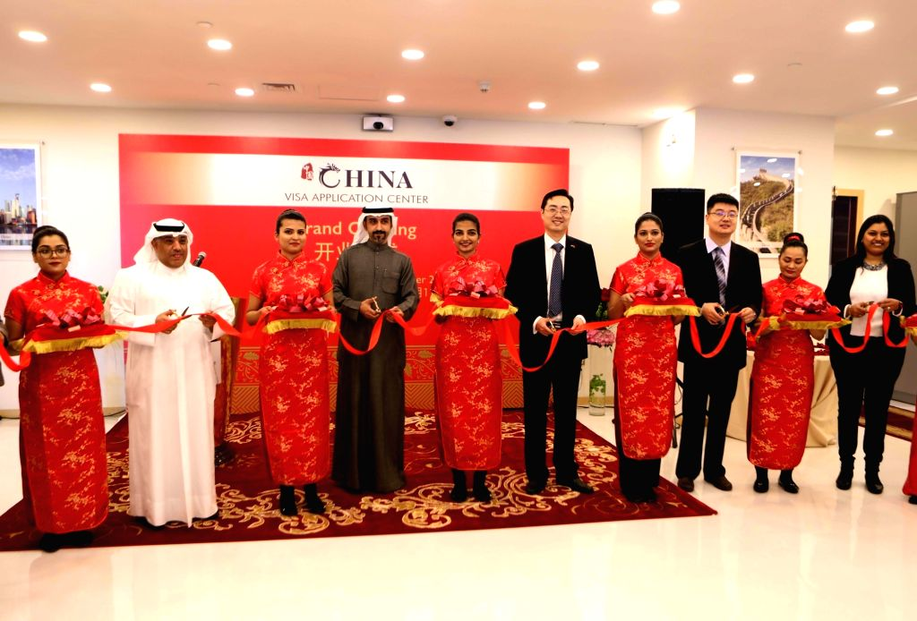 KUWAIT CITY, Dec. 11, 2018 - Charge d'affaires of the Embassy of China in Kuwait Zhao Liang (5th R) and Deputy Assistant Minister for Consular Affairs in the Ministry of Foreign Affairs of Kuwait ...