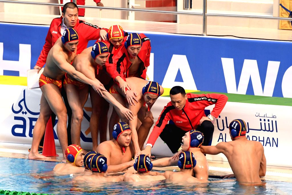 KUWAIT CITY, Dec. 13, 2019 - Members of China cheer during the preliminary match between China and Japan at the FINA World Men's Junior Water Polo Championships 2019 in Farwaniya Governorate, Kuwait, ...