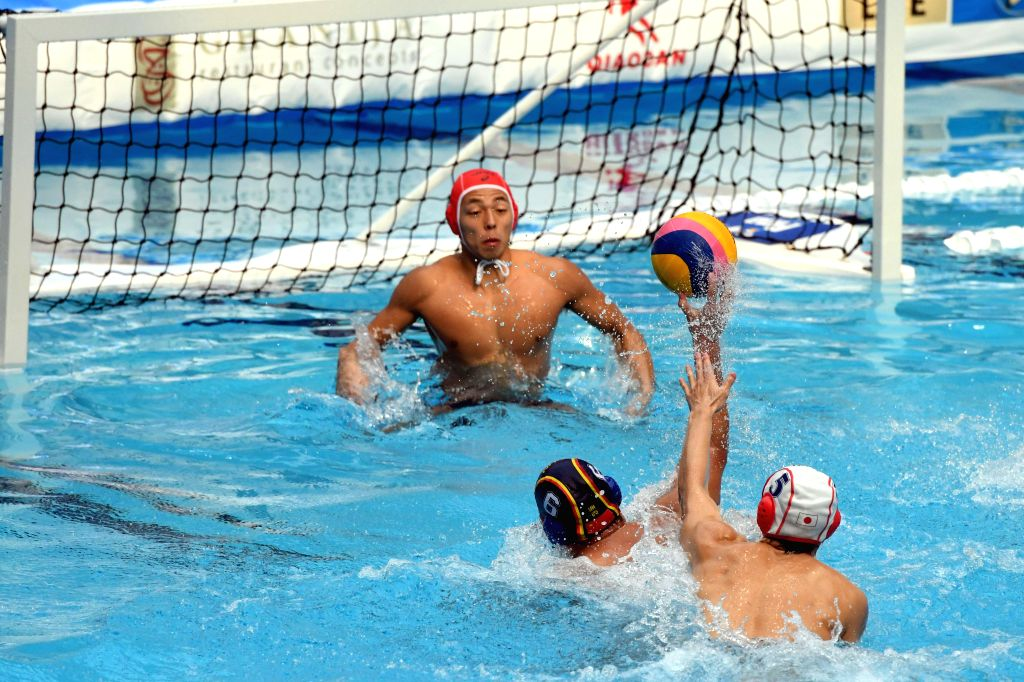 KUWAIT CITY, Dec. 13, 2019 - Wang Beiyi (C) of China shoots to score during the preliminary match between China and Japan at the FINA World Men's Junior Water Polo Championships 2019 in Farwaniya ...