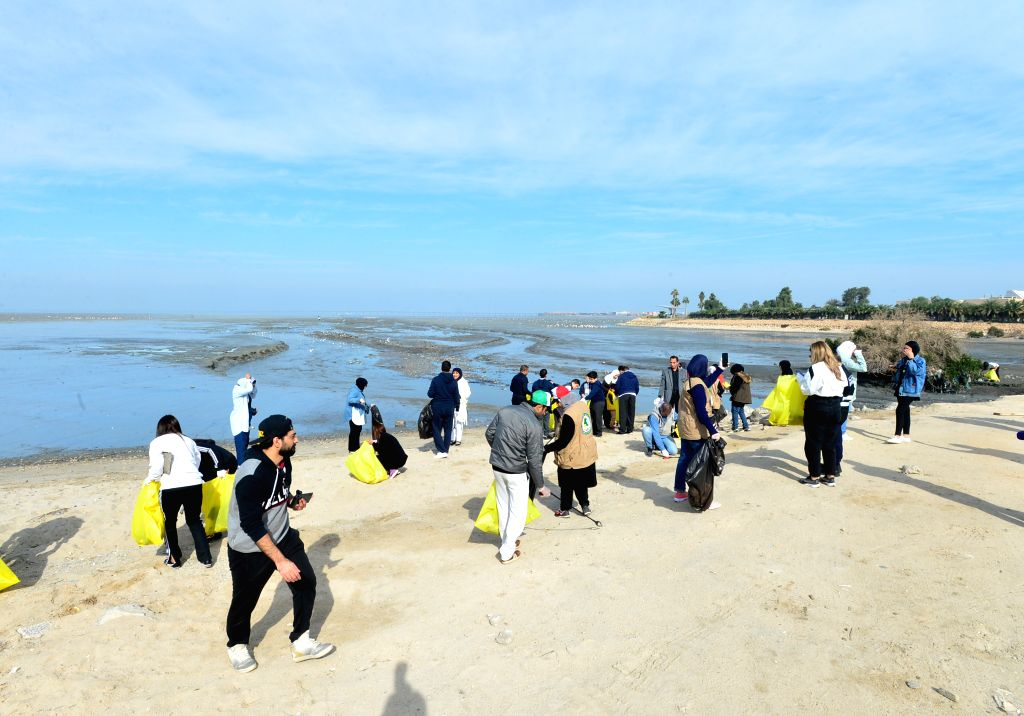KUWAIT CITY, Dec. 14, 2019 - People participate in a beach cleaning campaign in Kuwait City, Kuwait, on Dec. 14, 2019. Kuwait Institute for Scientific Research (KISR) launched on Saturday a campaign ...
