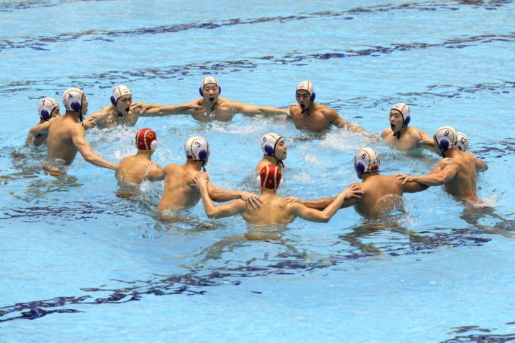 KUWAIT CITY, Dec. 14, 2019 - Players of China cheer during the preliminary match between China and South Africa at the FINA World Men's Junior Water Polo Championships 2019 in Farwaniya Governorate, ...