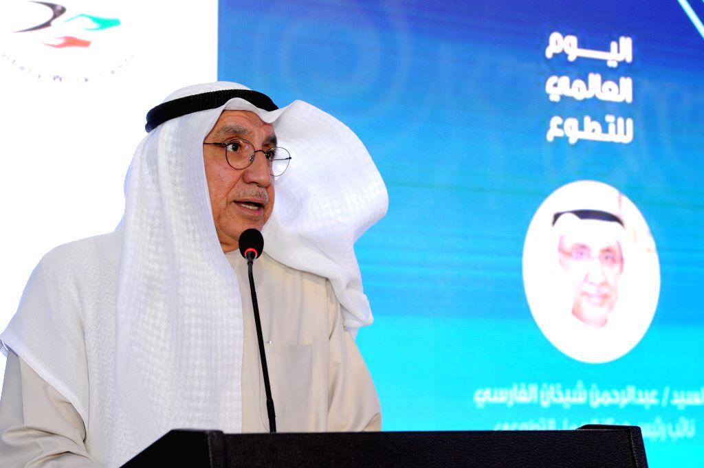 KUWAIT CITY, Dec. 4, 2019 - Abdul Rahman Al-Farsi, vice president of Kuwait Voluntary Work Center, speaks at a celebration ahead of the International Volunteer Day in Kuwait City, Kuwait, Dec. 4, ...