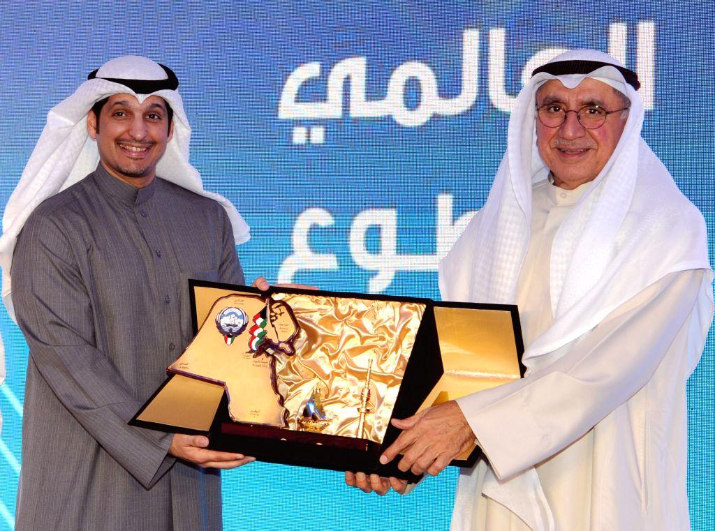 KUWAIT CITY, Dec. 4, 2019 - Abdulrahman Al-Mutairi (L), director general of Kuwait's Youth Public Authority (YPA), and Abdul Rahman Al-Farsi, vice president of Kuwait Voluntary Work Center, present ...