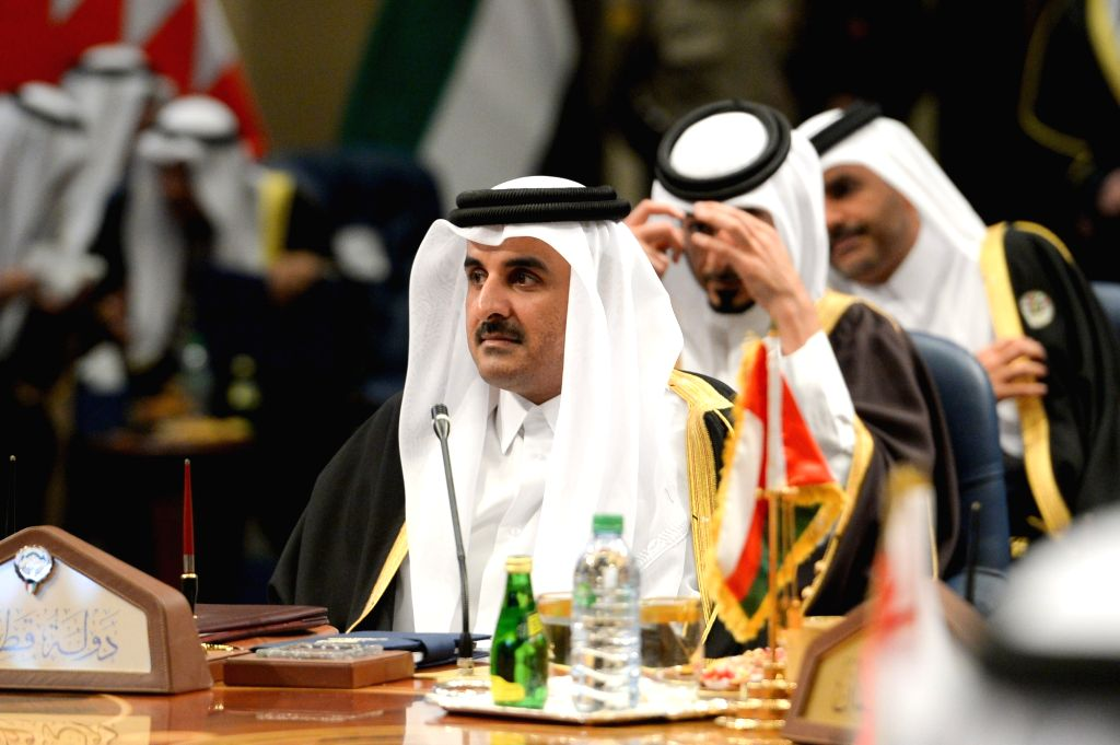KUWAIT CITY, Dec. 5, 2017 (Xinhua) -- Qatari Emir Sheikh Tamim bin Hamad al Thani (Front) attends the 38th Gulf Cooperation Council (GCC) Summit in Kuwait City, Kuwait, on Dec. 5, 2017. The 38th Gulf Cooperation Council (GCC) Summit ended in Kuwait o - Emir Sheikh Tamim